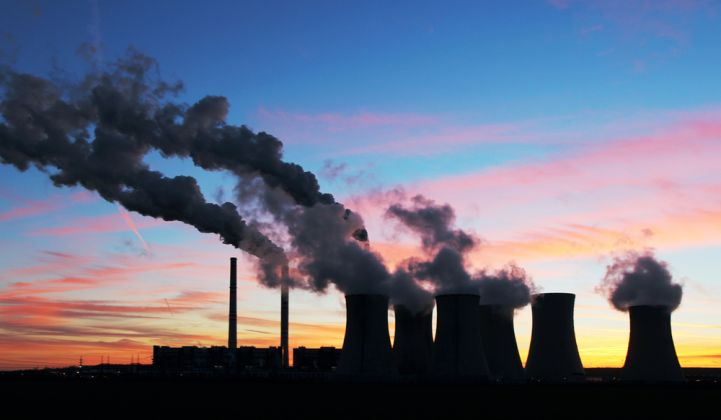 A coal-fired power plant at sunset.