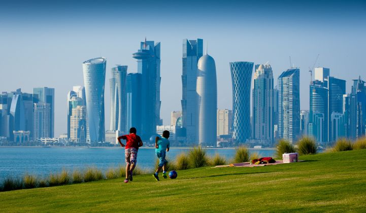Boys playing soccer in Doha. Qatar has promised to make its 2022 World Cup carbon-neutral.