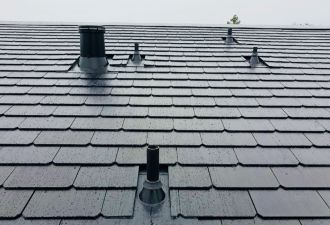 A closeup of one of the first Tesla Solar Roof installations.