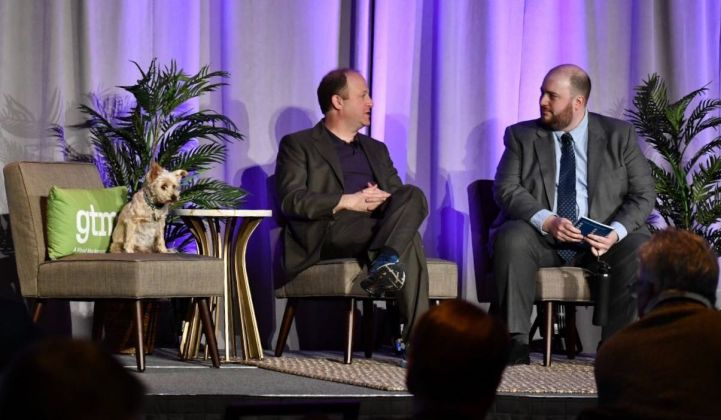 Gov. Polis on stage Wednesday at GTM's Energy Storage Summit. (Credit: Anna Conklin)