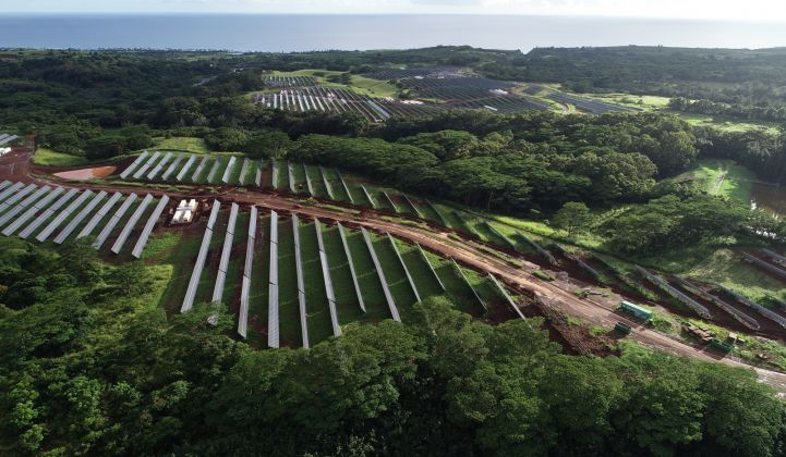 On a patch of rolling hills near Kauai's southern coast, solar panels and batteries work to offset fossil fuel usage.