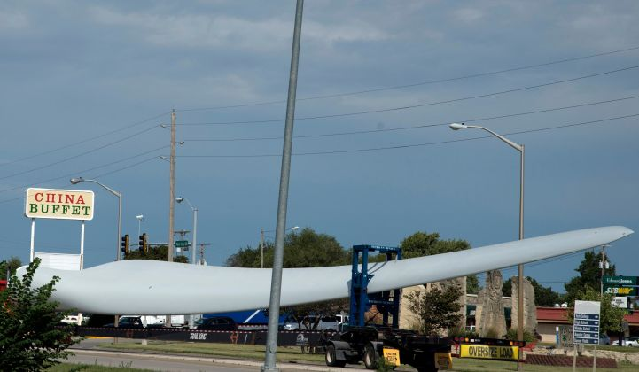 A wind rotor blade being transported to a project site in Kansas.