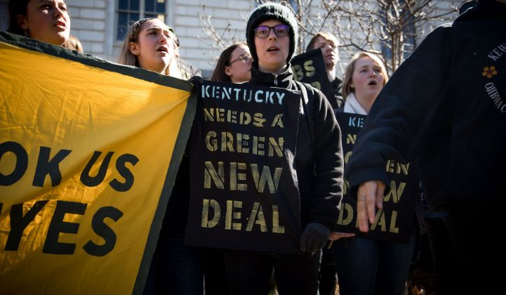 Activists protesting Kentucky Senator Mitch McConnell's opposition to the proposed Green New Deal.