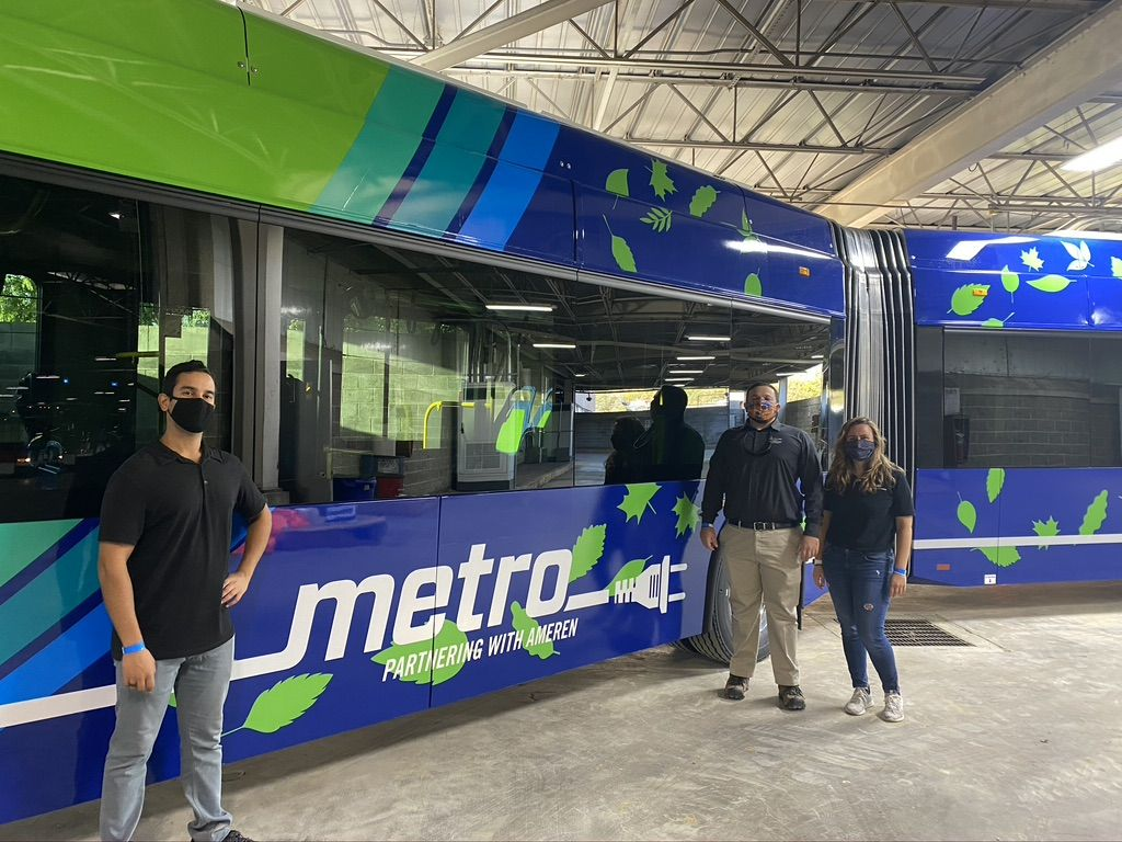 Zoheb Davar and Blanca Tarrgo from The Mobility House join Jonah Crespo of New Flyer in inspecting a new electric bus in St. Louis. (Credit: Mobility House)
