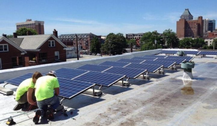 Workers install solar on the roof of a church in Greensboro, North Carolina.