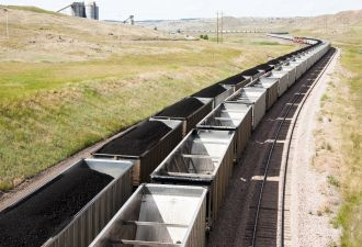 Rail cars loaded with coal mined in Wyoming. Many U.S. coal mining companies have gone bankrupt.