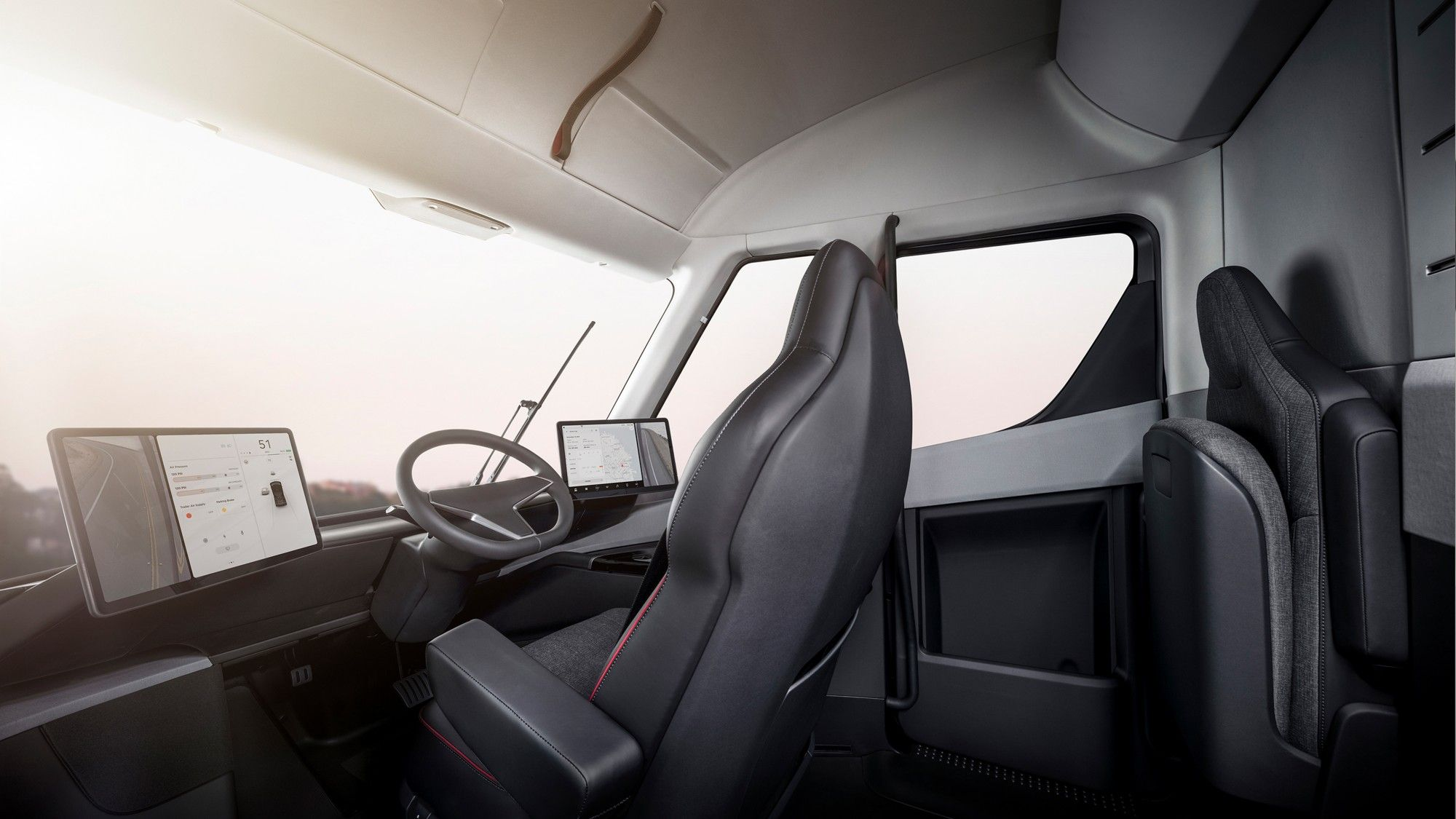 The Interior Of Tesla Semi With Two Model 3 Touchscreens
